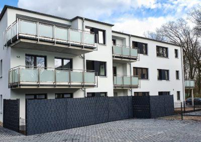 Neubau eines Mehrfamilienhauses mit 8 Wohneinheiten und einem Garagen-Hof